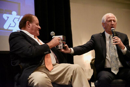 ESPN'S Chris Berman Accepts A Battle Of The Bay Snow Globe From Andy Dolich.
